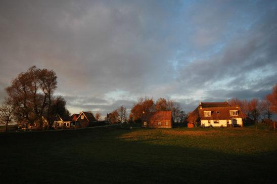 Laaksum in avondrood - FrieslandStock
